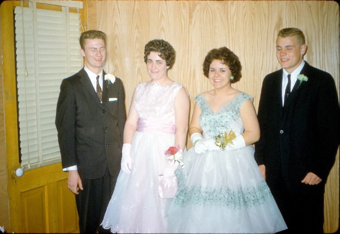 1. These high school students from Dubuque pose for a photo with their dates before prom night in 1961.