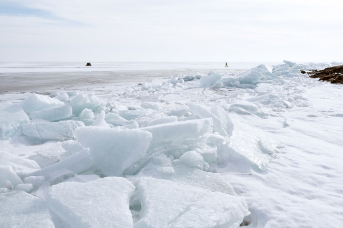 13. Another great shot of Superior shows massive blocks of ice piled as high as the people walking around them.