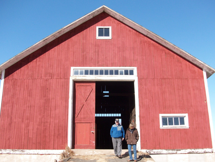 6. A perfectly classic early 20th century double-ramp barn in striking red. You can spot this barn at 115 School St, Agawam.