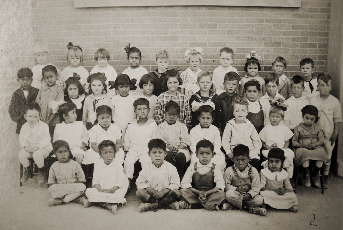 1. This class photo shows the students of a Globe school circa 1920.
