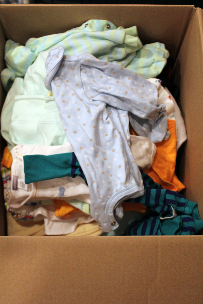 3. Boxes of outgrown children's clothing.