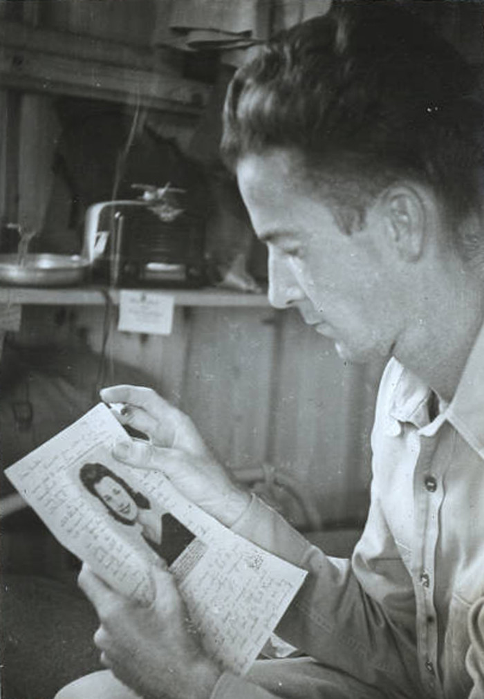 5. A soldier at the Columbia Army Air Base in 1941 reads a letter from his sweetheart.