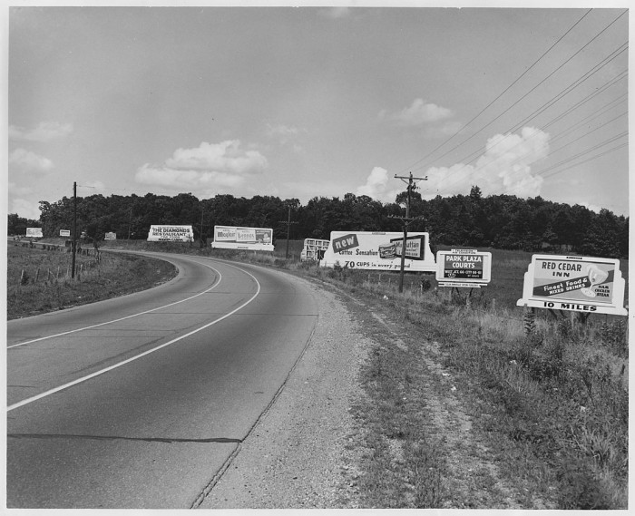 5.	Billboards along Highway 66 west of its junction with Highway 50 in rural Missouri, 1952.