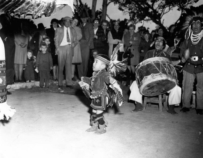 8. This cute kid is participating in a dance at the Grand Canyon around 1950.