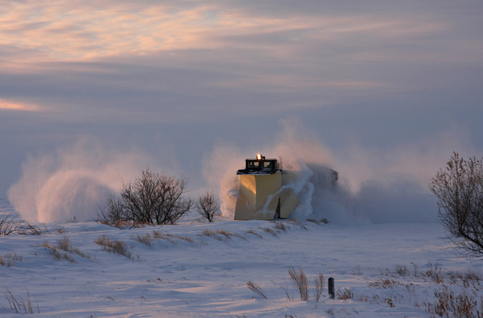 4. One of the first to rise early morning, a train plow clearing snow.
