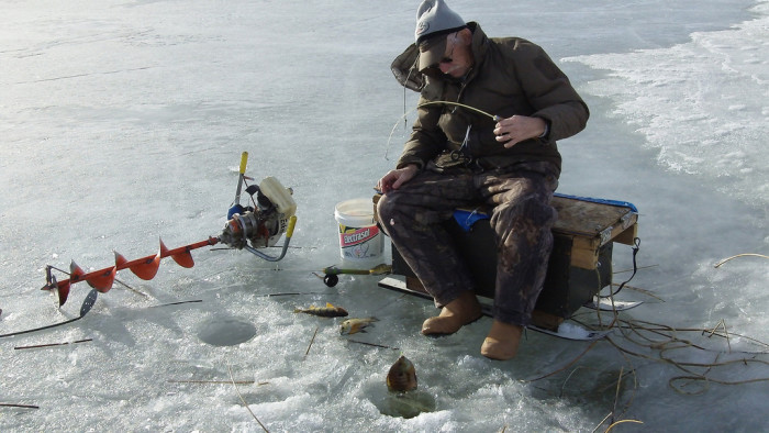 8. Be brave and head out onto the ice for some ice fishing.
