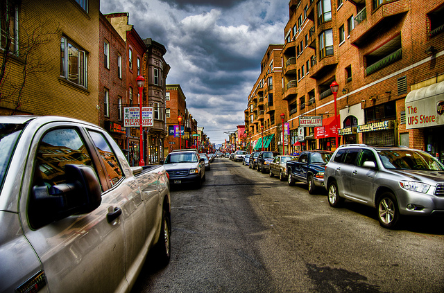 1. The colorful Philadelphia streets near the Italian Market provide a dramatic backdrop.
