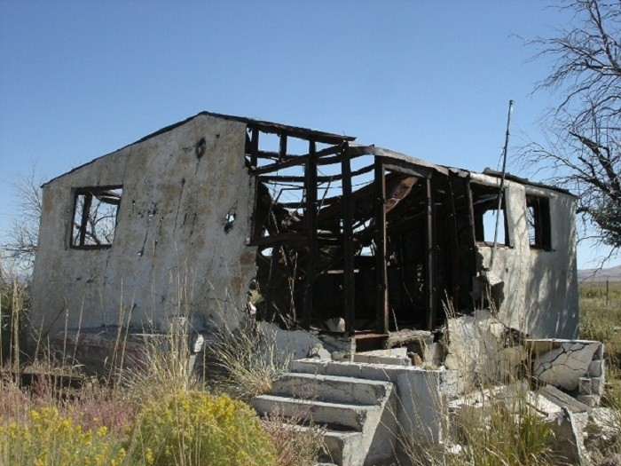 3. It looks as though nature isn't finished reclaiming this abandoned concrete house, which is located somewhere in the middle of Nevada.