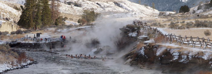 11. Soaking in a hot spring while enjoying the winter scenery.