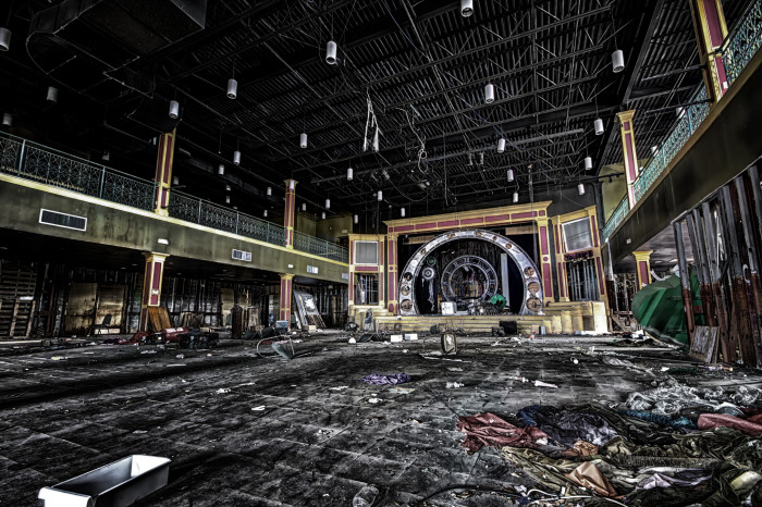 An abandoned theater at the park. You can still see the water lines on the walls.