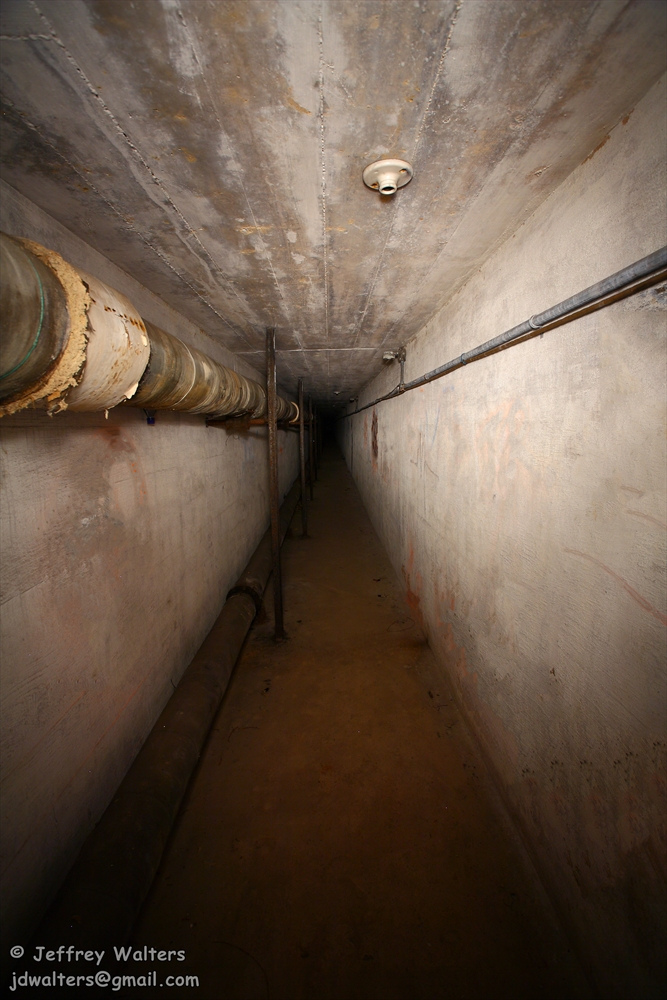 There are several underground tunnels, most of which now contain a few feet of standing water. The tunnel pictured here leads out of the Children's Building.