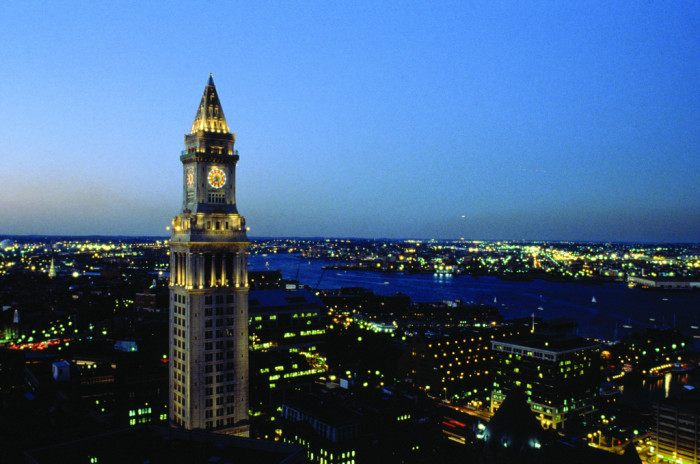 5. The Boston Customs House towers over a glowing city.