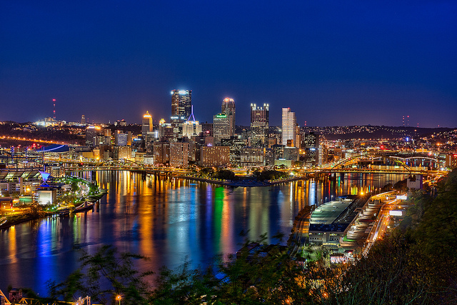 1. Pittsburgh's skyline glitters against the night sky and reflects where the three rivers meet.
