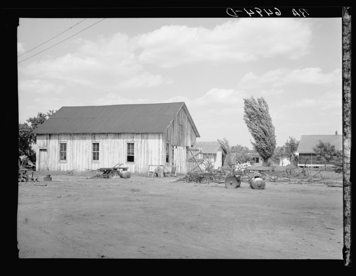 7. Although less common with the onset of the Great Depression, blacksmith shops, such as this one on a Sunflower plantation, could still be found in some towns.