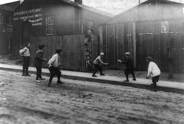16. Young children playing in the streets of Fall River.