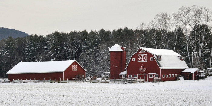 4. This large red barn in Franklin stands in solid contrast to the light layer of snow against the backdrop of tall pines and mountains.