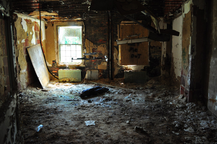The ceiling is completely gone from this room, leaving it in shambles.