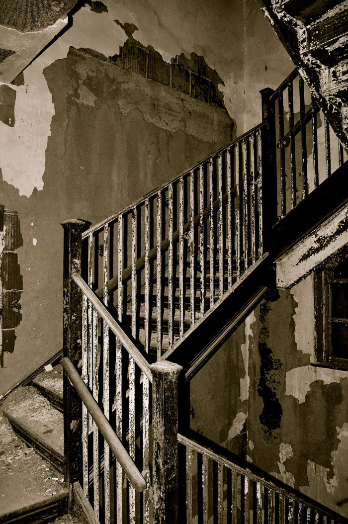 This staircase full of twists and turns still stands strong while the walls crumble around it.