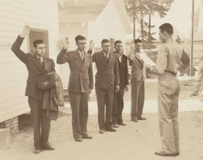 8. New enlistees at Fort Jackson, SC taking the oath. 1941.