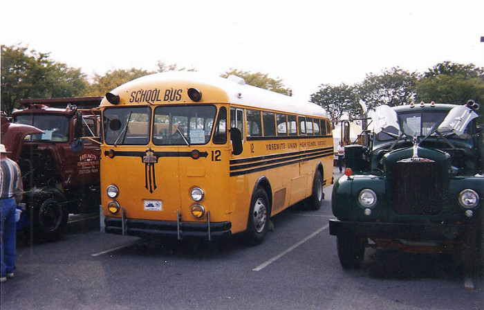 12. This photograph was taken in 1997, but it features cars from the late 1950s. Most notable is that Crown supercoach schoolbus. This picture was taken in Hershey.