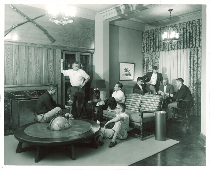 8. This group of University of Iowa students hangs out in Hillcrest during the 1950s.