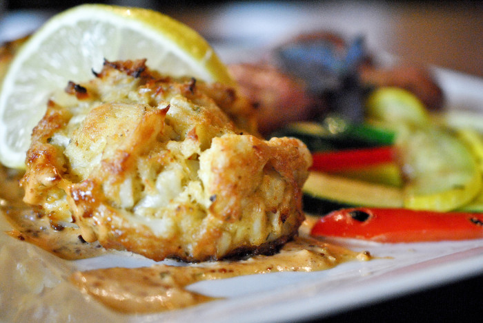 1) Take 'em to any restaurant with crab cakes and they'll be happy.