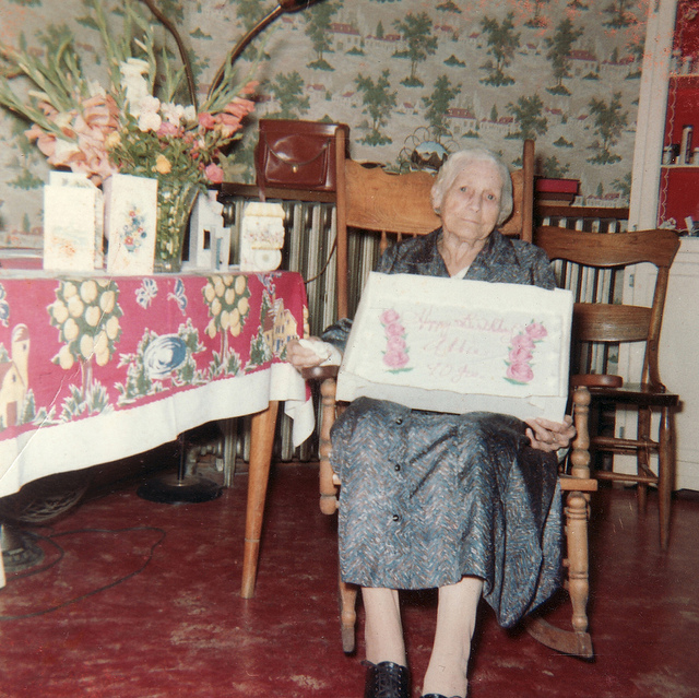 8. A woman celebrates her 90th birthday, 1950s style.