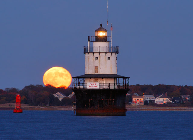 6. The Butler Flats Lighthouse in New Bedford has a stunning nighttime companion.