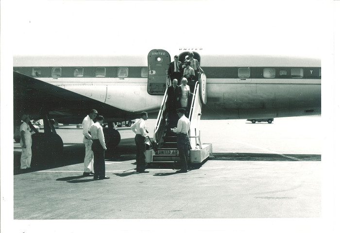 8. This group of people step off a plane in Iowa during the 1960s. You won't find this model in the skies anymore.