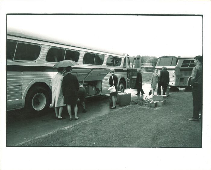 9. This group of people get ready to take a bus trip in the 1960s.