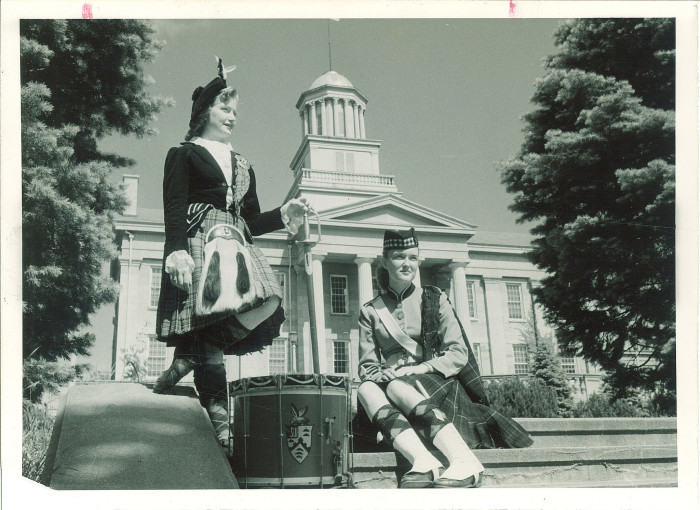 10. These two members of the Scottish Highlanders Club stand in front of the old capitol building in Iowa City.