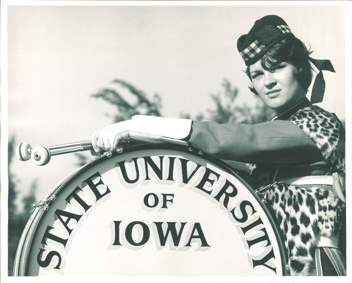 11. This gal is a drummer for the Highlanders Club at State University of Iowa.