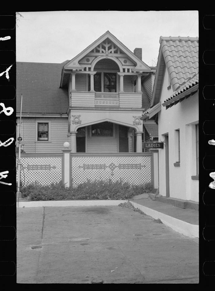 11. Gas station on Dodge Street encroaching on private home, Omaha, Nebraska - 1938