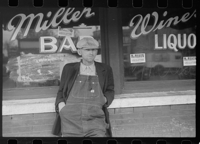 13. Man in front of saloon in stockyard district, South Omaha, Nebraska - 1938