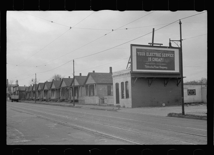 6. A row of small homes for workers lines a street in Omaha's Italian district - 1938.