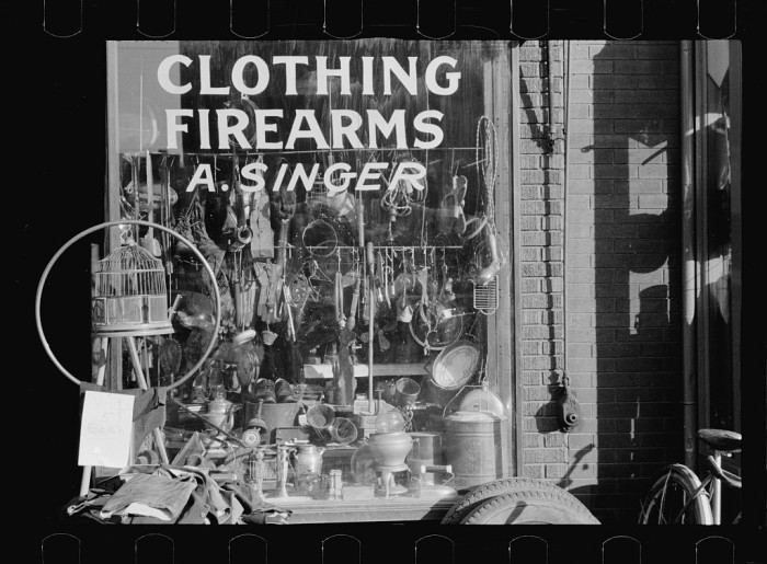 16. Secondhand goods. Note surgical instruments in window, Omaha, Nebraska - 1938