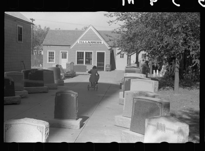23. Girl playing among tombstones, Lexington, Nebraska - 1938