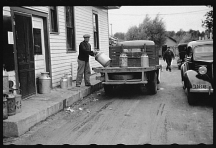 9. The Farm Security Administration is helping out locals. This is a cooperative creamery where they are busy unloading milk cans.