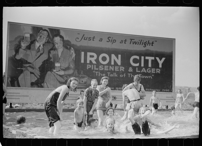 11. Steelworkers' children pose for a picture as they play in a swimming pool in Pittsburgh in July of 1938.