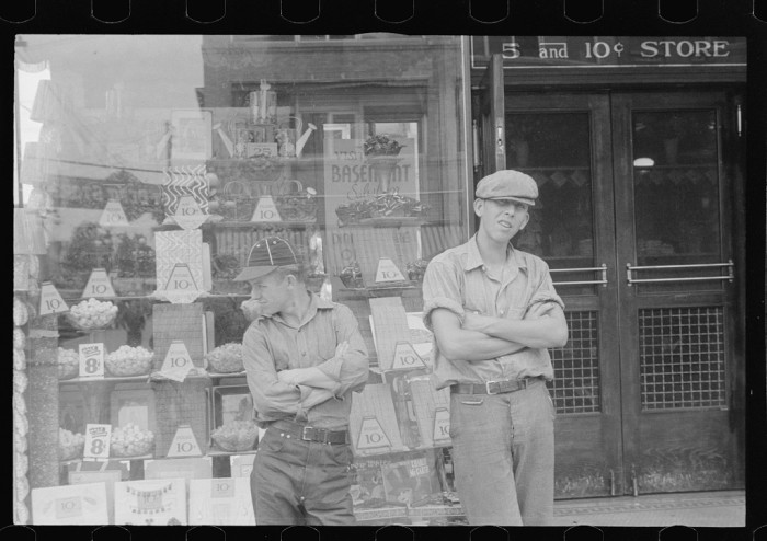 "13. ""Two boys standing in front of candy store window. Street scene in Circleville, Ohio."""