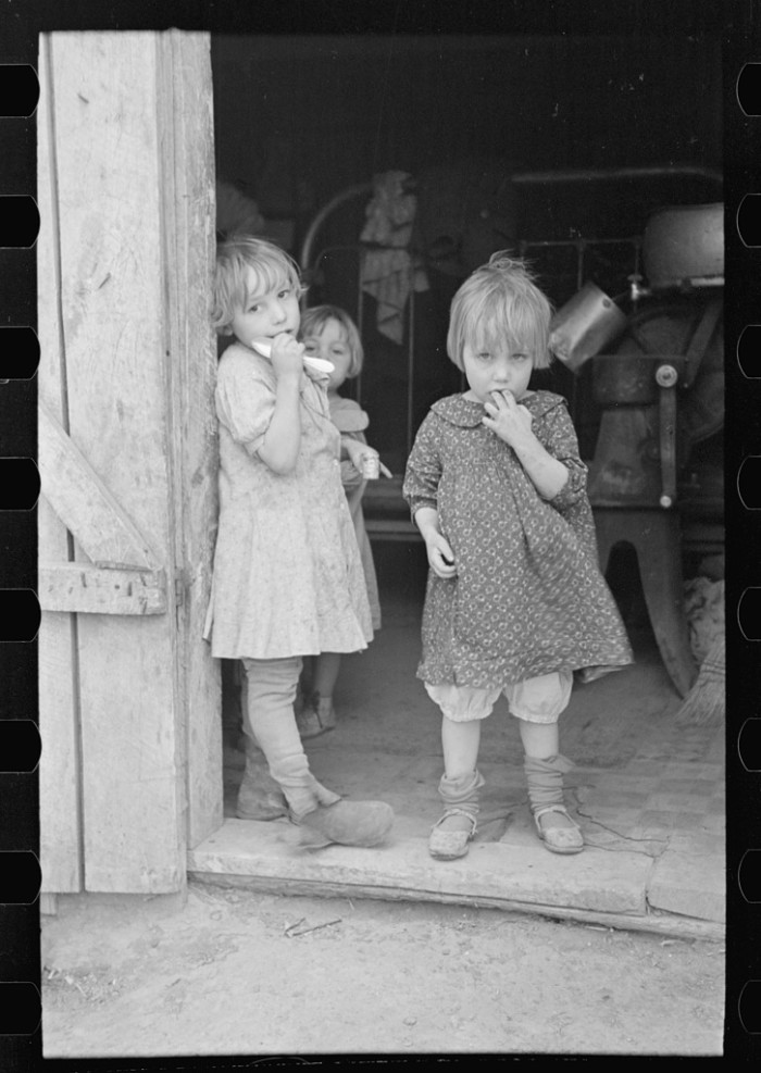 5. These children stand in the doorway of their family's shack in Woodbury.