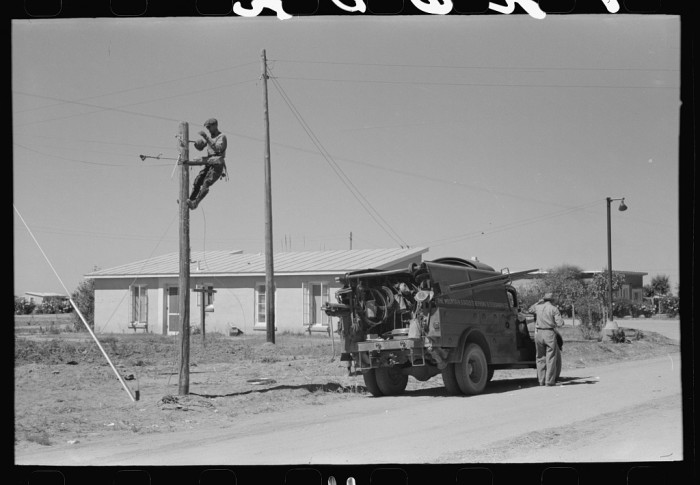 10. Many families in the 1930s and 1940s were starting to become larger consumers and enjoyed modern amenities they had never before had. This photo shows a telephone lineman doing some repairs.