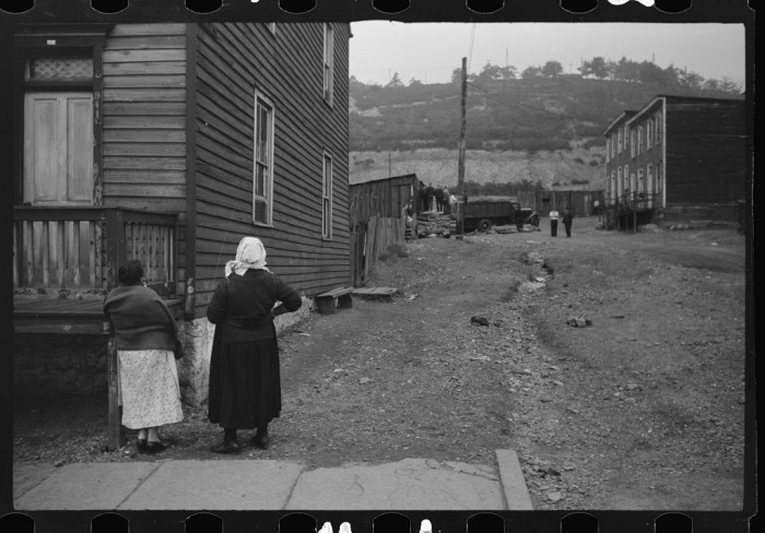 2. You can tell from these ladies' dress, though, that this photograph was taken decades ago. They talk outside their house in Shenandoah in 1938.