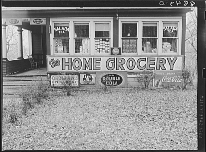 28. Home turned into grocery store. Omaha, Nebraska - 1938