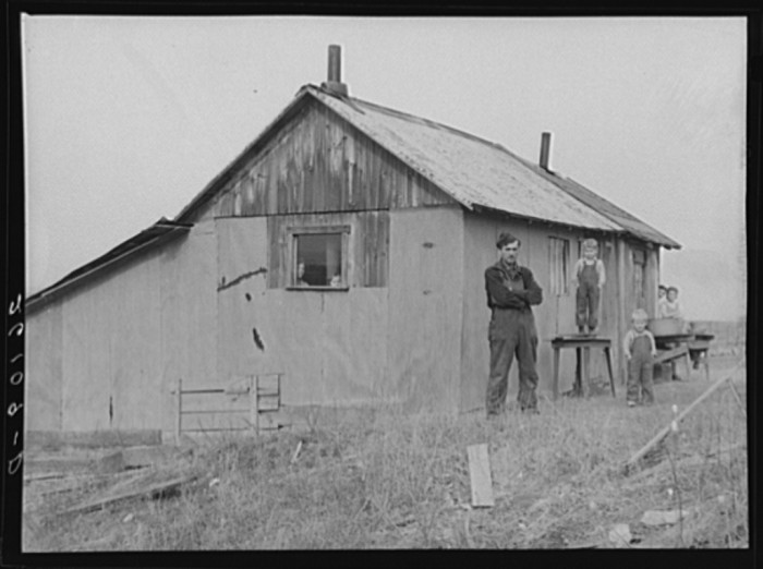 5. A family stands outside their barn in Bedford county, 1937.