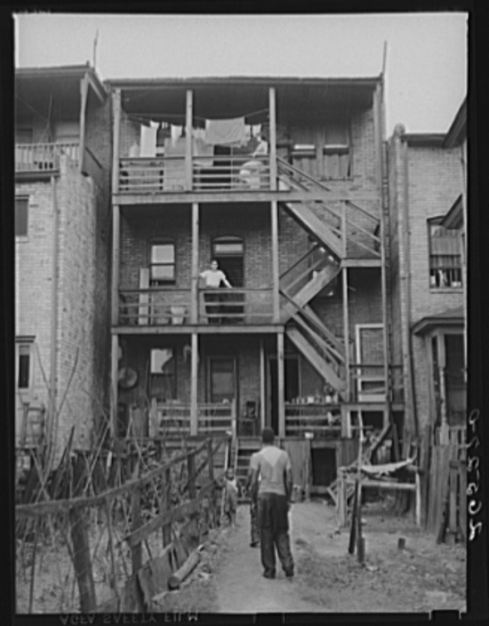 7. At the opposite end of the social spectrum, many families lived in tenements such as this one in Midland, 1938.