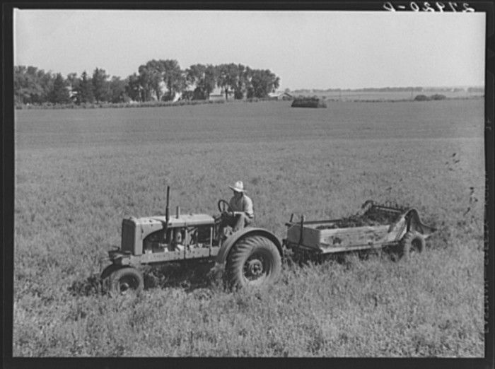 8. A farmer in Jasper County spreads manure on his field.