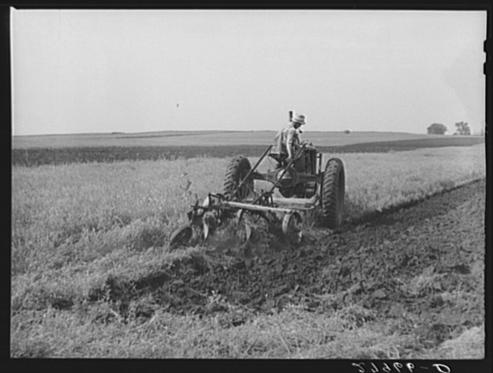 10. This farmer plows his field in Story County.