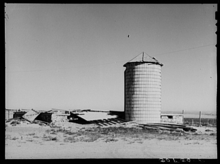 """3. """"Old silo and remains of barn wrecked by wind near Williston, North Dakota"""""""
