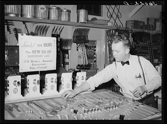 """15. Stores were small and specialized in what they sold. This man is selling """"modern, beautiful, economical"""" hardware."""